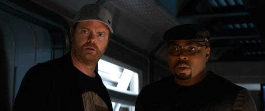 """Rainn Wilson (as Morris) and Page Kennedy (as DJ) are in awe of the shark's killing power in """"The Meg."""""""