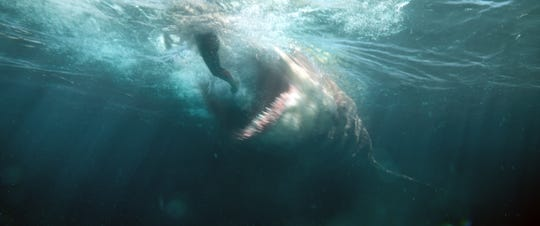 "The megalodon goes after another victim in ""The Meg."""