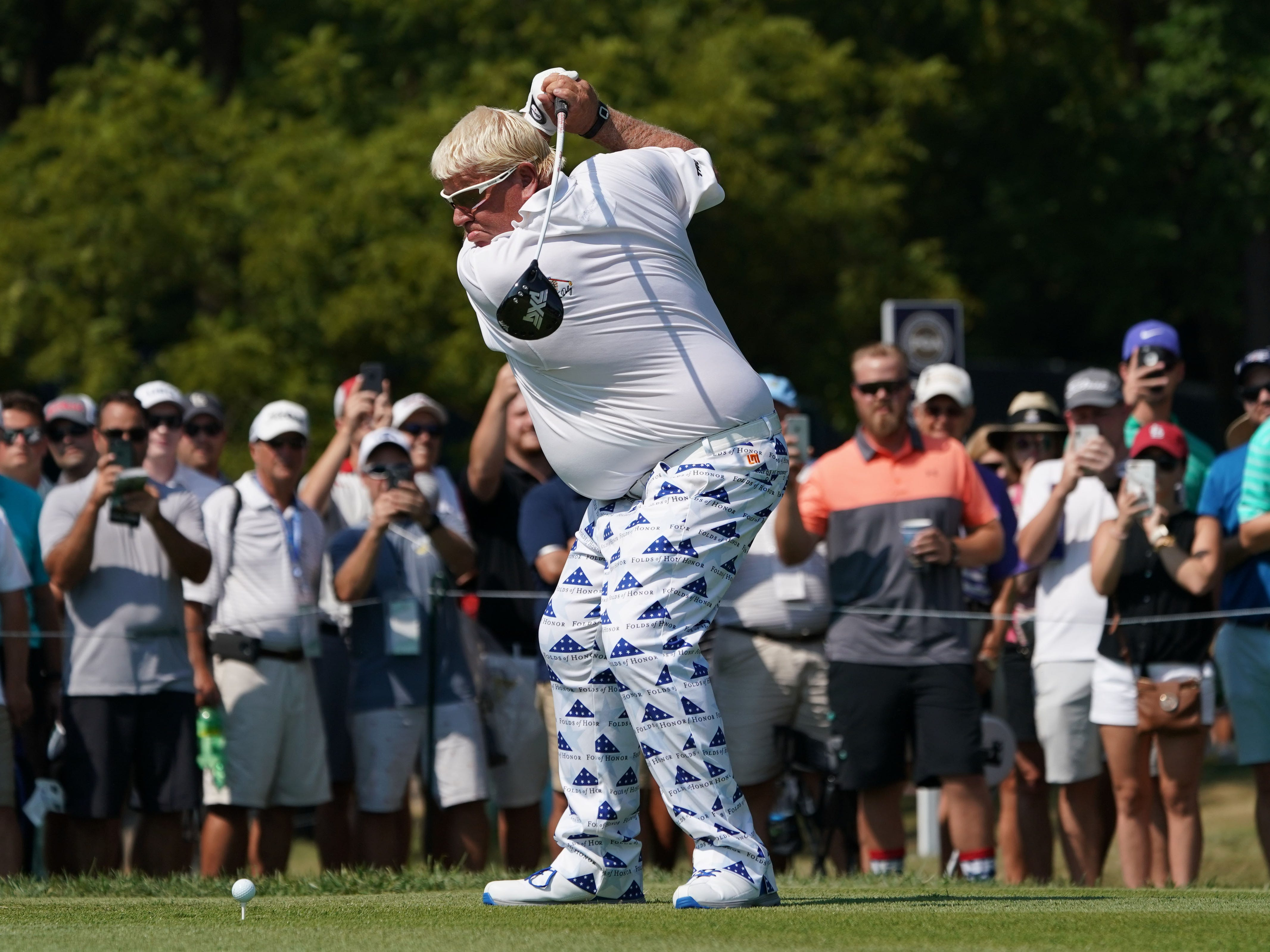 John Daly hits his tee shot on the 12th hole during the second round.