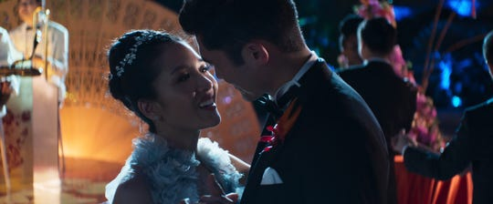 "Rachel (Constance Wu) and Nick (Henry Golding) share a dance in ""Crazy Rich Asians."""