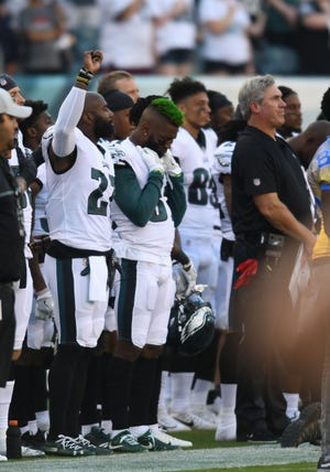 Philadelphia Eagles defensive back Malcolm Jenkins (27) raises his fist during the national anthem before the start of the preseason game against the Pittsburgh Steelers at Lincoln Financial Field.