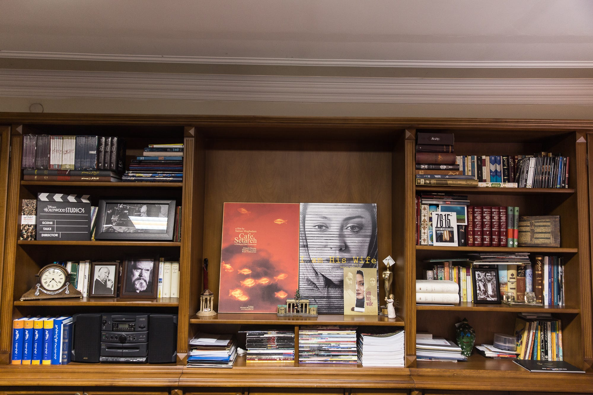 A bookshelf is filled with movie-related posters, photos and memorabilia at the offices of the Hedayat Film Co., an Iranian movie production firm, in Tehran.
