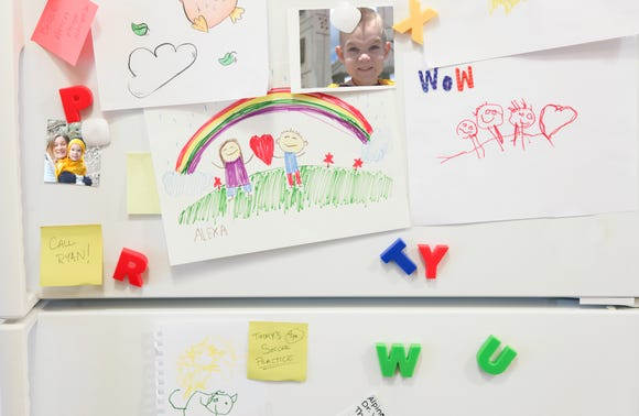 Fridge space is limited when it comes to kids' artwork.