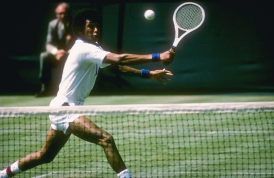 Arthur Ashe runs for the ball during a match at Wimbledon in England in an undated photo.