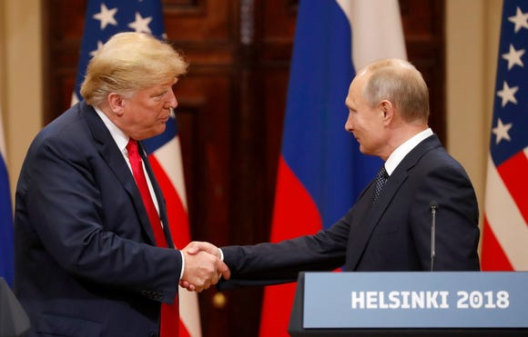 President Donald J. Trump and Russian President Vladimir Putin shake hands during a joint press conference after  their summit talks at the Presidential Palace in Helsinki, Finland, on July 16, 2018.
