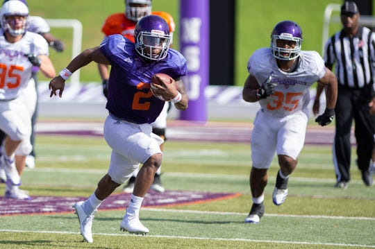 NSU sophomore Kaleb Fletcher (2) runs the ball downfield during the Demons' first intrasquad game Saturday.