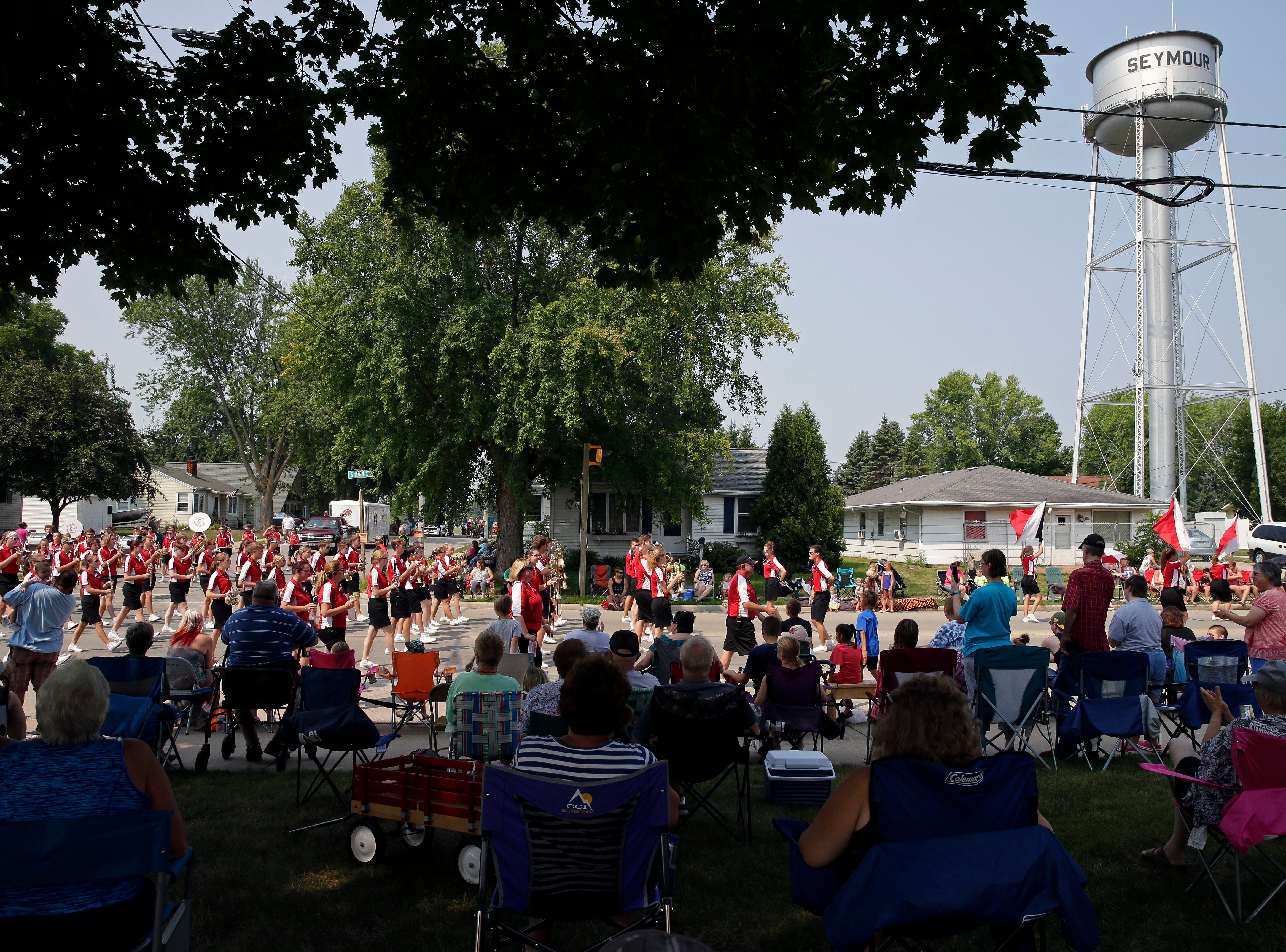 The Pulaski High School Band marches as the Hamburger Parade takes place during the 30th annual Burger Fest Saturday, August 11, 2018, in Seymour, Wis.