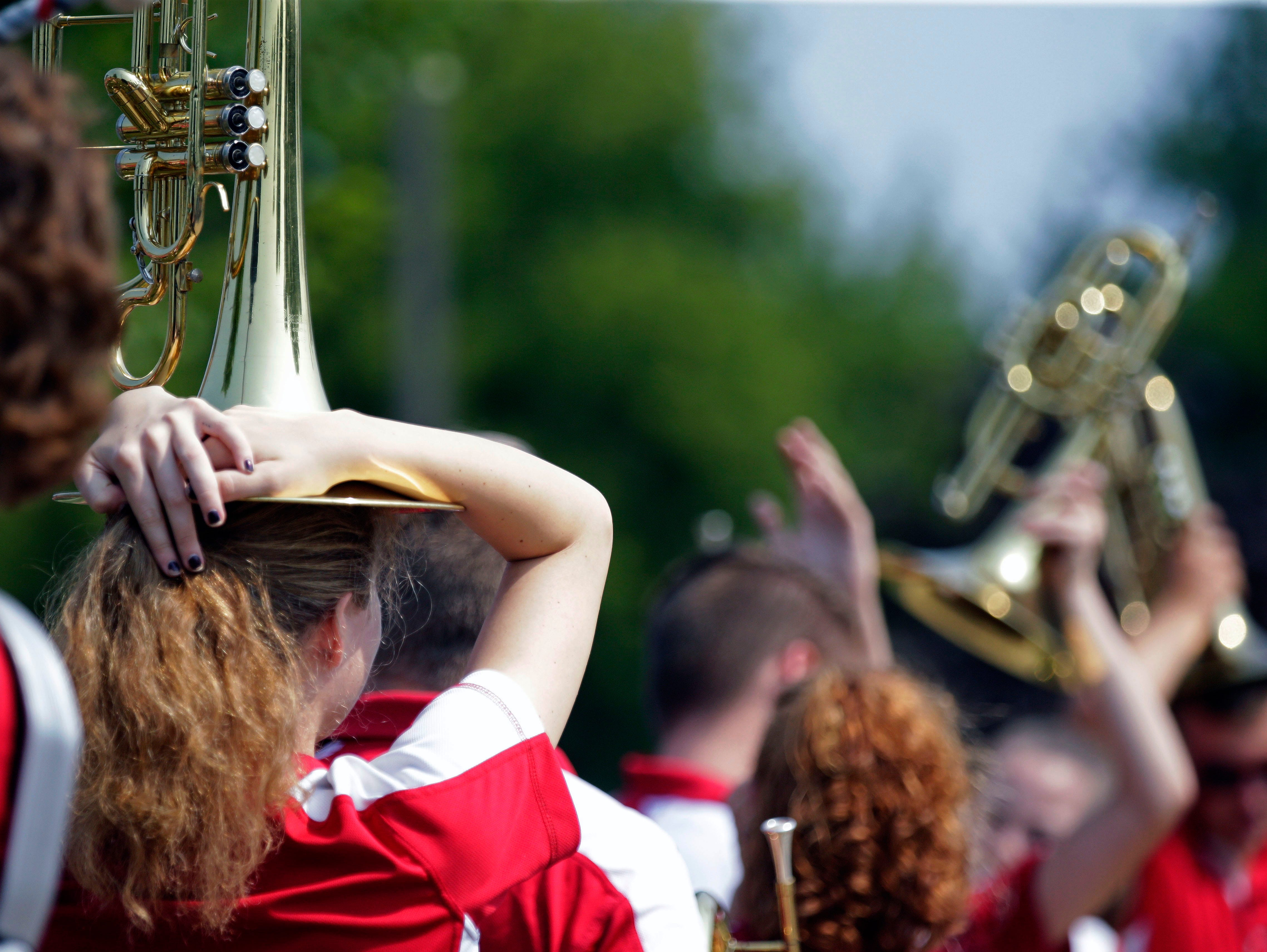 Members of the Pulaski High School Band wait for the start of the Hamburger Parade during the 30th annual Burger Fest Saturday, August 11, 2018, in Seymour, Wis.
