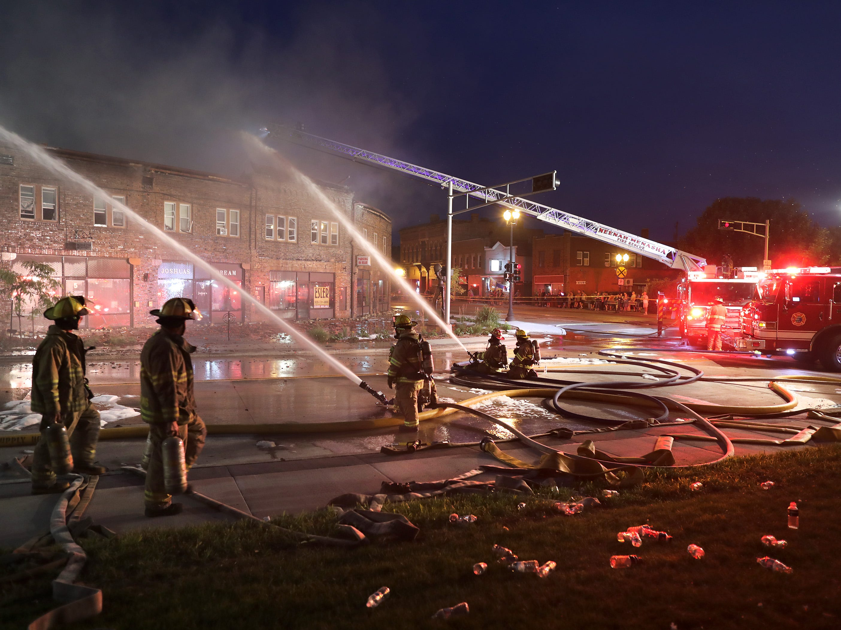 Firefighters from multiple fire departments battle a structure fire in the Brin Building along the block of 1 Main Street on Friday, August 10, 2018, in downtown Menasha, Wis.  Wm. Glasheen/USA TODAY  NETWORKWisconsin