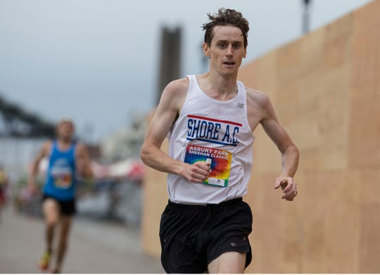 The Asbury Park 5K race makes its way along city streets and finishes after a stretch on the boardwalk. First place male is Justin Scheid of Rocksbury. Asbury Park, NJSaturday, August 11, 2018@dhoodhood