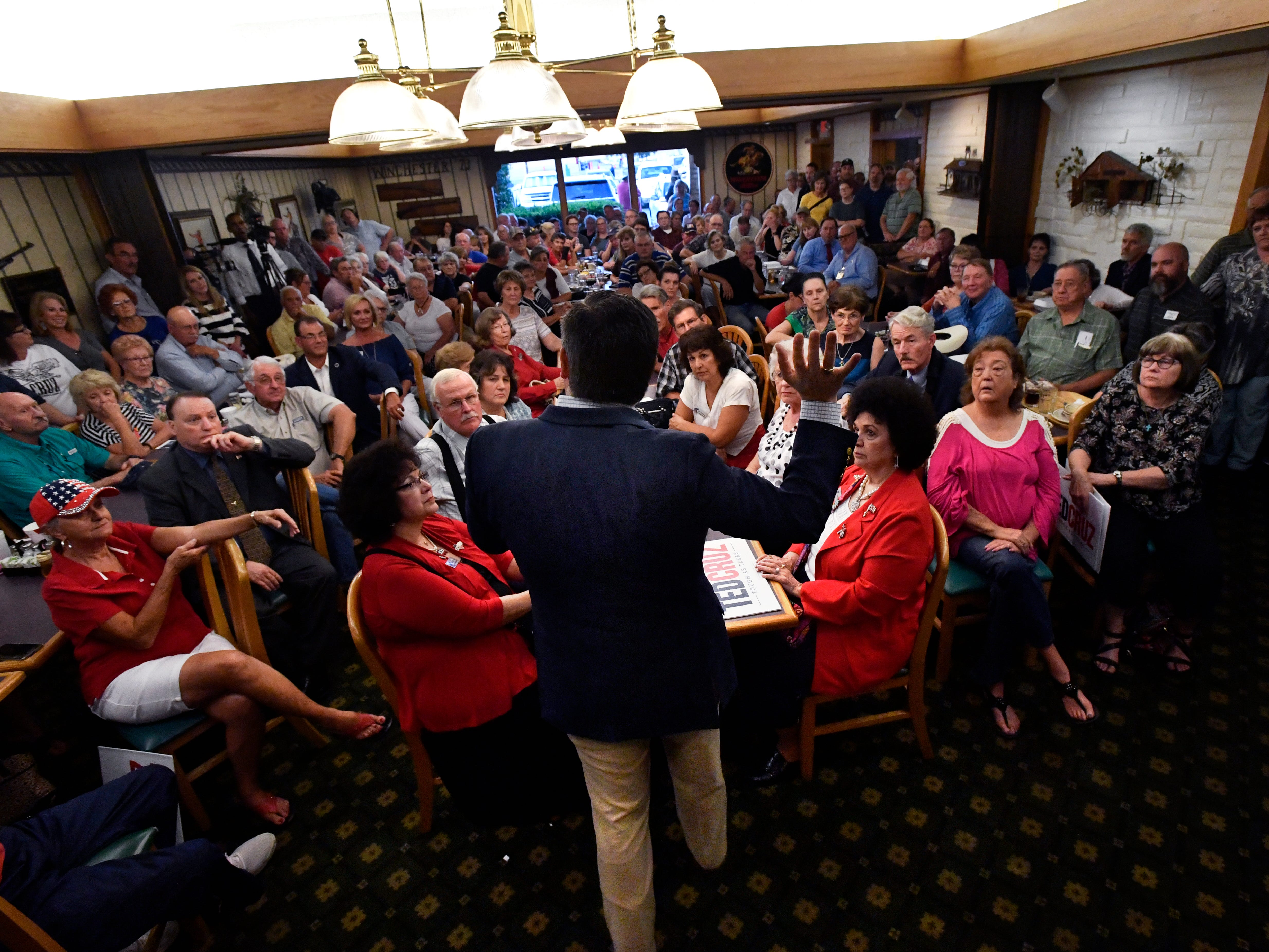 Audience members listen as Senator Ted Cruz answers their questions during a town hall meeting in Brownwood Thursday August 9, 2018. Cruz spoke to and greeted supporters for over 90 minutes at Underwood's Cafeteria.