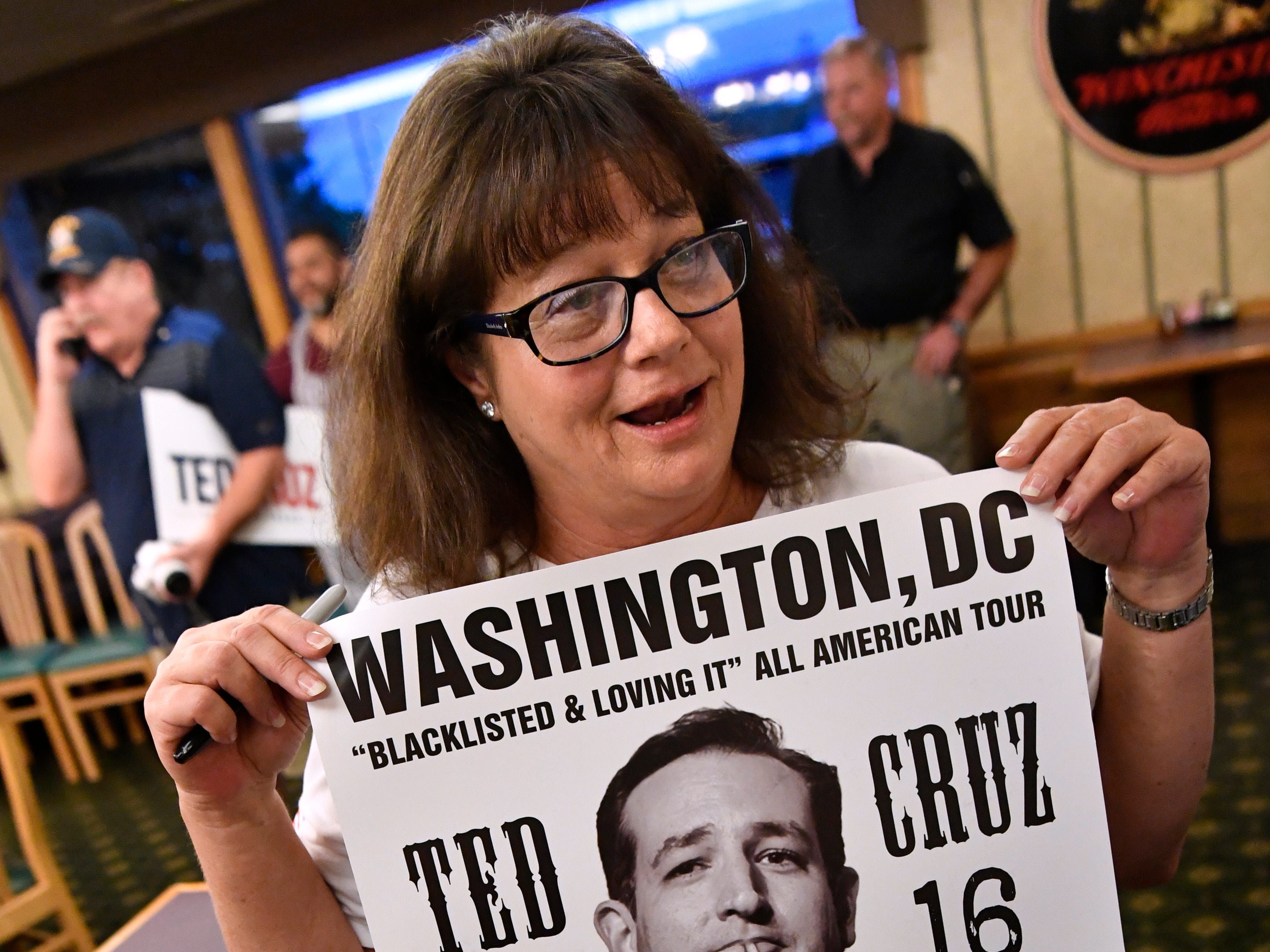 Denise Vannoy holds the poster she brought for Senator Ted Cruz to sign Thursday August 9, 2018. The picture is a composite made by Los Angeles artist Sabo. Cruz spoke to and greeted supporters for over 90 minutes in a town hall meeting at Underwood's Cafeteria in Brownwood.