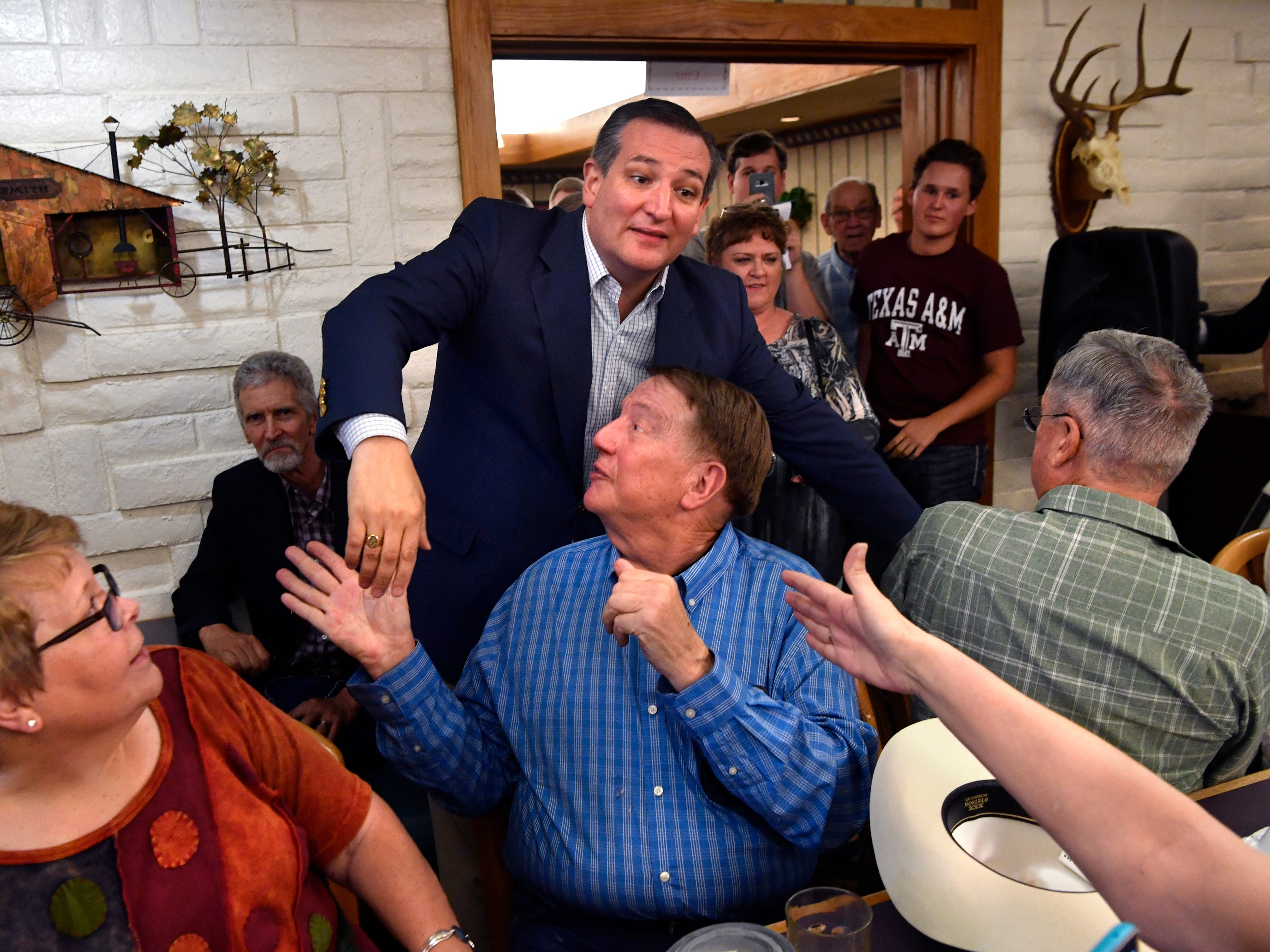 Squeezing through the crowded room, Senator Ted Cruz shakes as many hands as he can while making his way to the front Thursday August 9, 2018 in Brownwood. Cruz spoke to and greeted supporters for over 90 minutes at a town hall meeting in Underwood's Cafeteria.