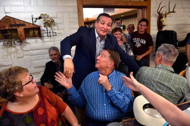 Squeezing through the crowded room, U.S. Sen. Ted Cruz shakes as many hands as he can while making his way to the front Thursday in Brownwood. Cruz spoke to and greeted supporters for over 90 minutes at a town hall meeting at Underwood's Cafeteria.
