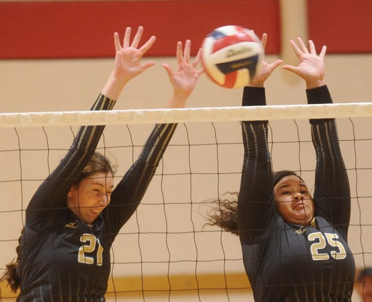 Abilene High's Sydney Lawler (21) and Sydnee Killam (25) try to block a Brock shot at the net. Brock won the match 23-25, 25-22, 25-14 in a first-round consolation match in Gold Bracket play at the Bev Ball Classic on Saturday, Aug. 11, 2018 at Cougar Gym.