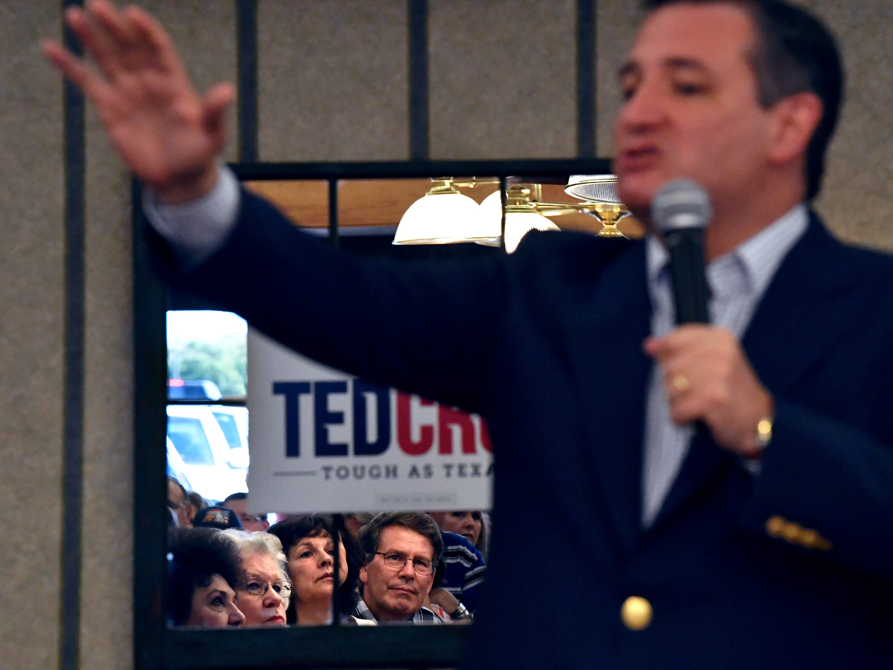 Audience members are reflected in a mirror as Senator Ted Cruz addresses them during a town hall meeting Thursday August 9, 2018 in Brownwood. Cruz spoke to and greeted supporters for over 90 minutes at Underwood's Cafeteria.
