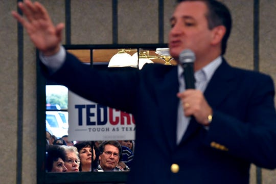 Audience members are reflected in a mirror as U.S. Sen. Ted Cruz addresses them during a town hall meeting Thursday in Brownwood. Cruz spoke to and greeted supporters for over 90 minutes at Underwood's Cafeteria.