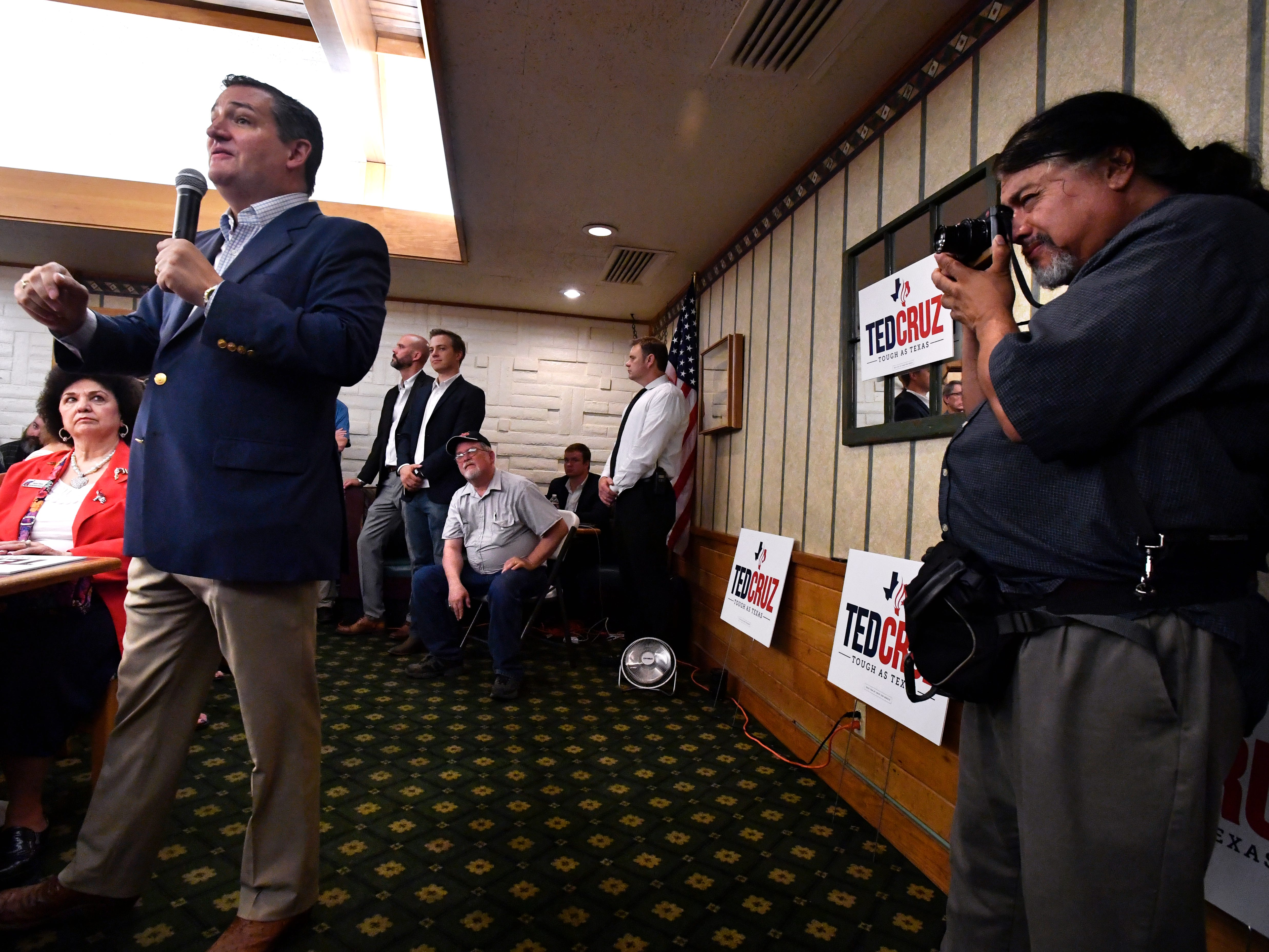 San Antonio Express-News photographer Billy Calzada photographs Senator Ted Cruz during Thursday's town hall meeting in Brownwood August 9, 2018. Media from across the state and nation attended the 90-minuted event.