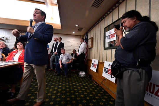 San Antonio Express-News photographer Billy Calzada photographs U.S. Sen. Ted Cruz during Thursday's town hall meeting in Brownwood. Media from across the state and nation attended the 90-minute event.