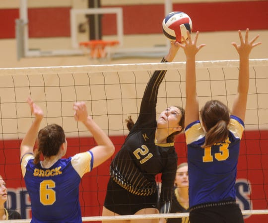 Abilene High's Sydney Lawler (21) hits between two Brock defenders. Brock won the first-round consolation match 23-25, 25-22, 25-14 during Gold Bracket play at the Bev Ball Classic on Saturday, Aug. 11, 2018 at Cougar Gym.