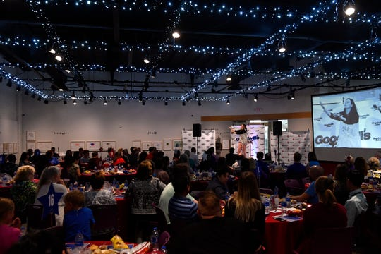 The audience watches Cynthia Newman perform during Goodwill's Got Talent at the National Center for Children's Illustrated Literature on  Thursday. Organizers said the program was geared toward highlighting the people who work for Goodwill and to raise awareness that it is more than a discount store.