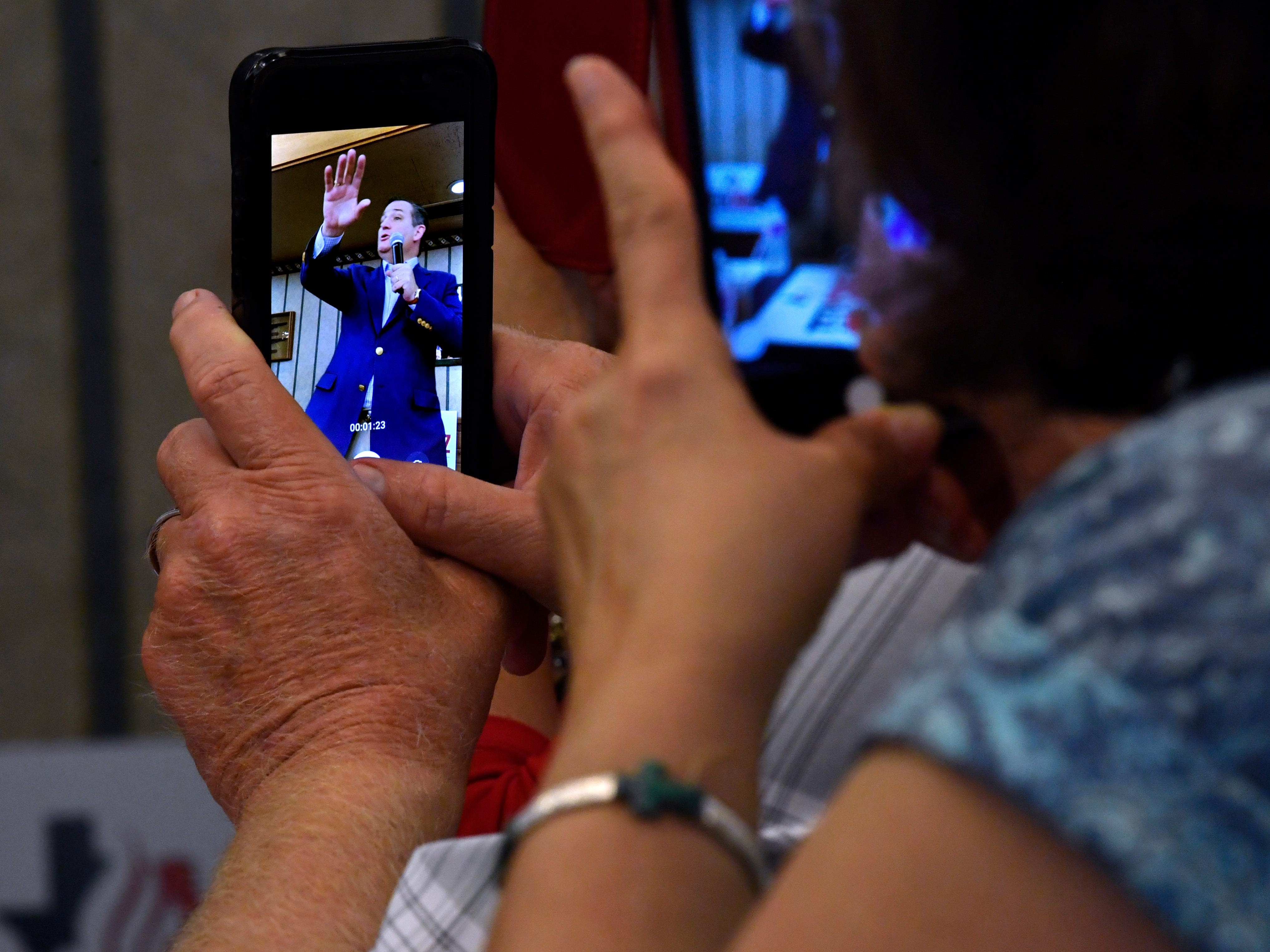 Attendees record Senator Ted Cruz's remarks during a town hall meeting Thursday August 9, 2018 in Brownwood. Cruz spoke to and greeted supporters for over 90 minutes at Underwood's Cafeteria.