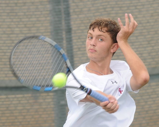 Abilene Cooper's Aaron Hines returns a shot in his No. 1 boys singles match against Lubbock-Cooper's Brice Bradshaw. Bradshaw won 6-2, 6-0. Lubbock Cooper also won the match 13-6 on Friday, Aug. 10, 2018 at the Cooper tennis courts.