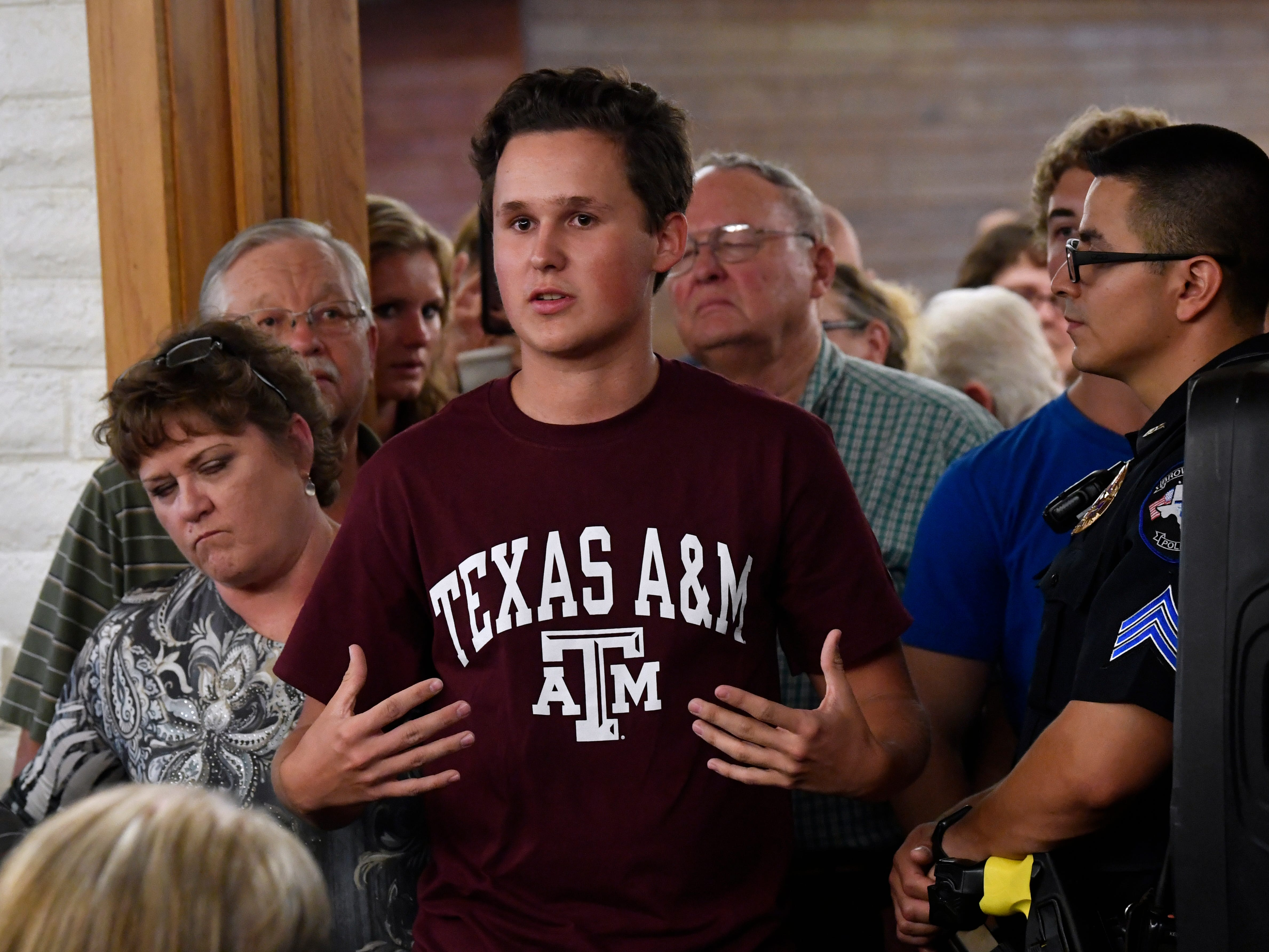 Alex Dobson, an incoming senior at Early High School, asks Senator Ted Cruz a question about the censoring of free speech in social media during a town hall in Brownwood Thursday August 9, 2018. Cruz spoke to and greeted supporters for over 90 minutes at Underwood's Cafeteria.