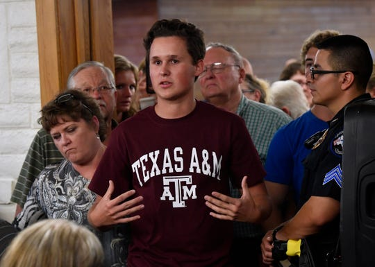 Alex Dobson, a senior at Early High School, asks U.S. Sen. Ted Cruz about the censoring of free speech in social media during a town hall in Brownwood on Thursday.