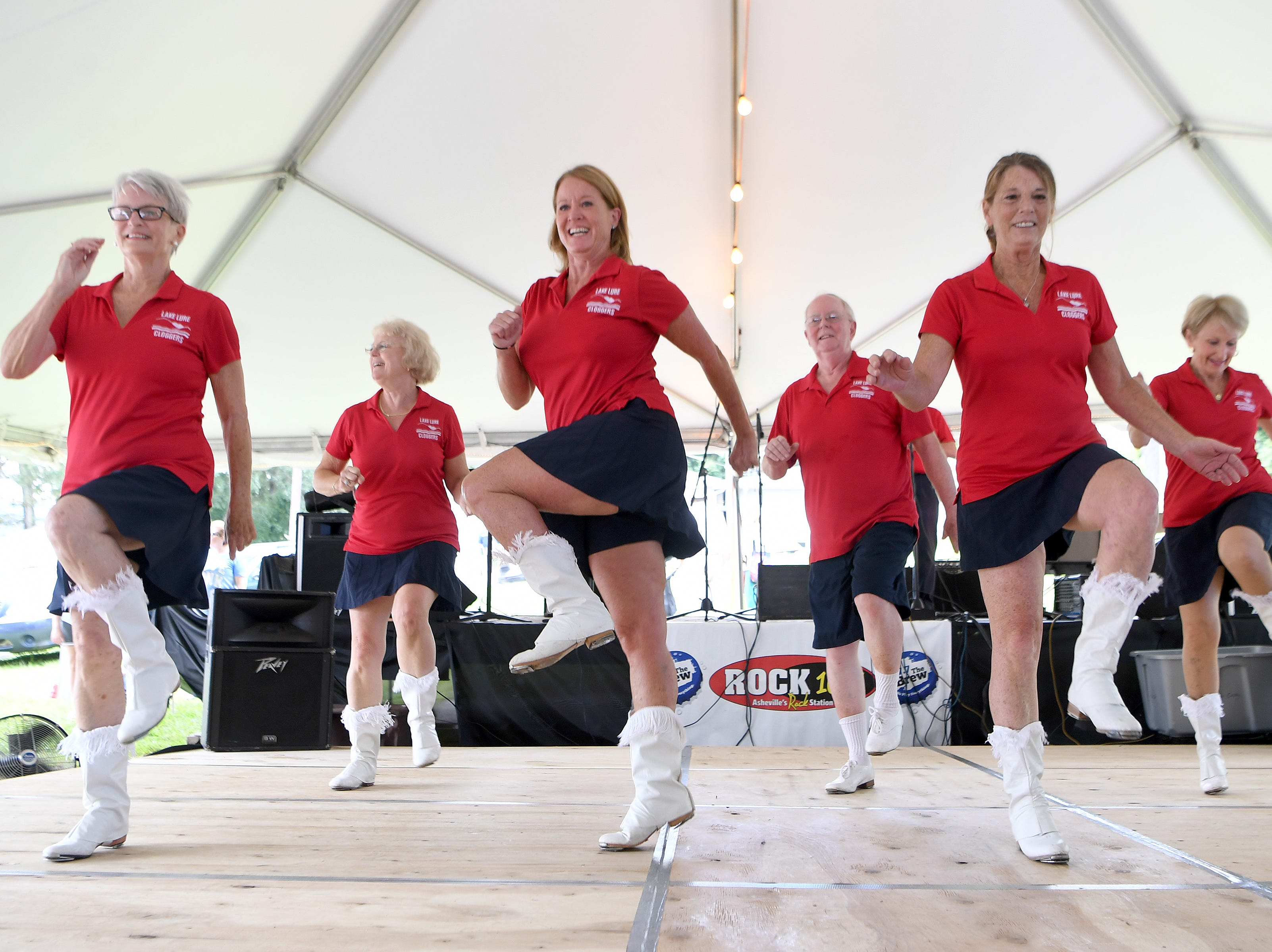 The Lake Lure Cloggers perform during the 41st annual Sourwood Festival in Black Mountain on Saturday, Aug. 11, 2018.