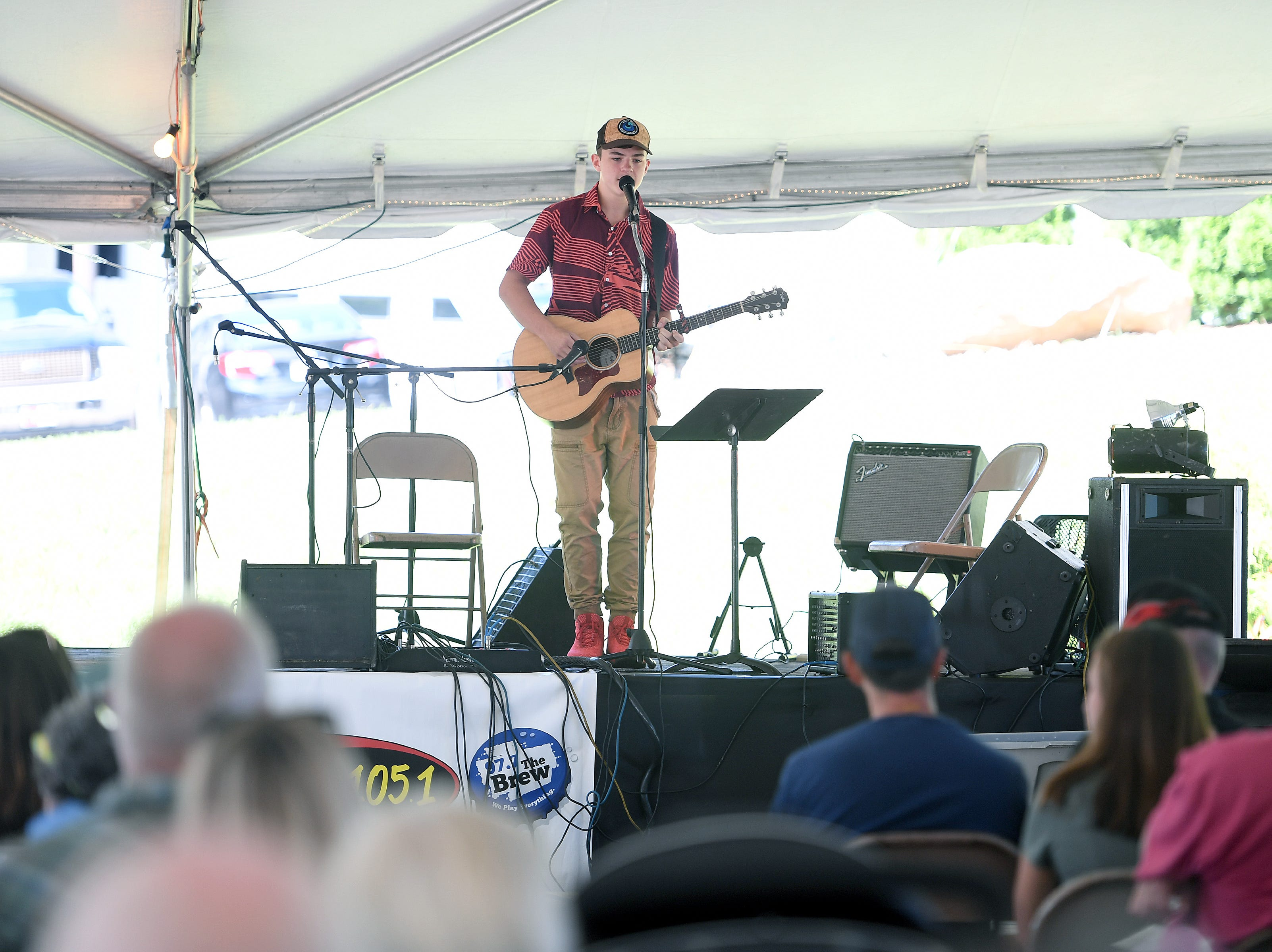 This year's Sourwood Idol winner Tristian Robinson, 16, performs during the 41st annual Sourwood Festival in Black Mountain on Saturday, Aug. 11, 2018.