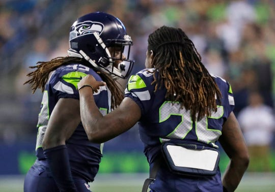 Seahawks cornerback Shaquill Griffin right, greets his twin brother, Seahawks linebacker Shaquem Griffin, left, after Shaquem made a tackle Thursday.