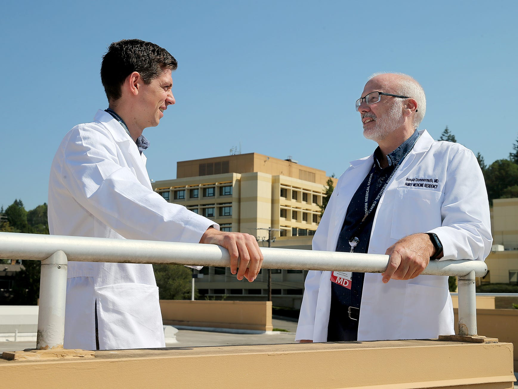 Harrison Medical Center resident Jacob Van Fleet, left, is one of eight residents who will undergo three years of training through Harrison's new family medicine residency program. They are supervised by physicians, including Ronald Dommermuth, right.