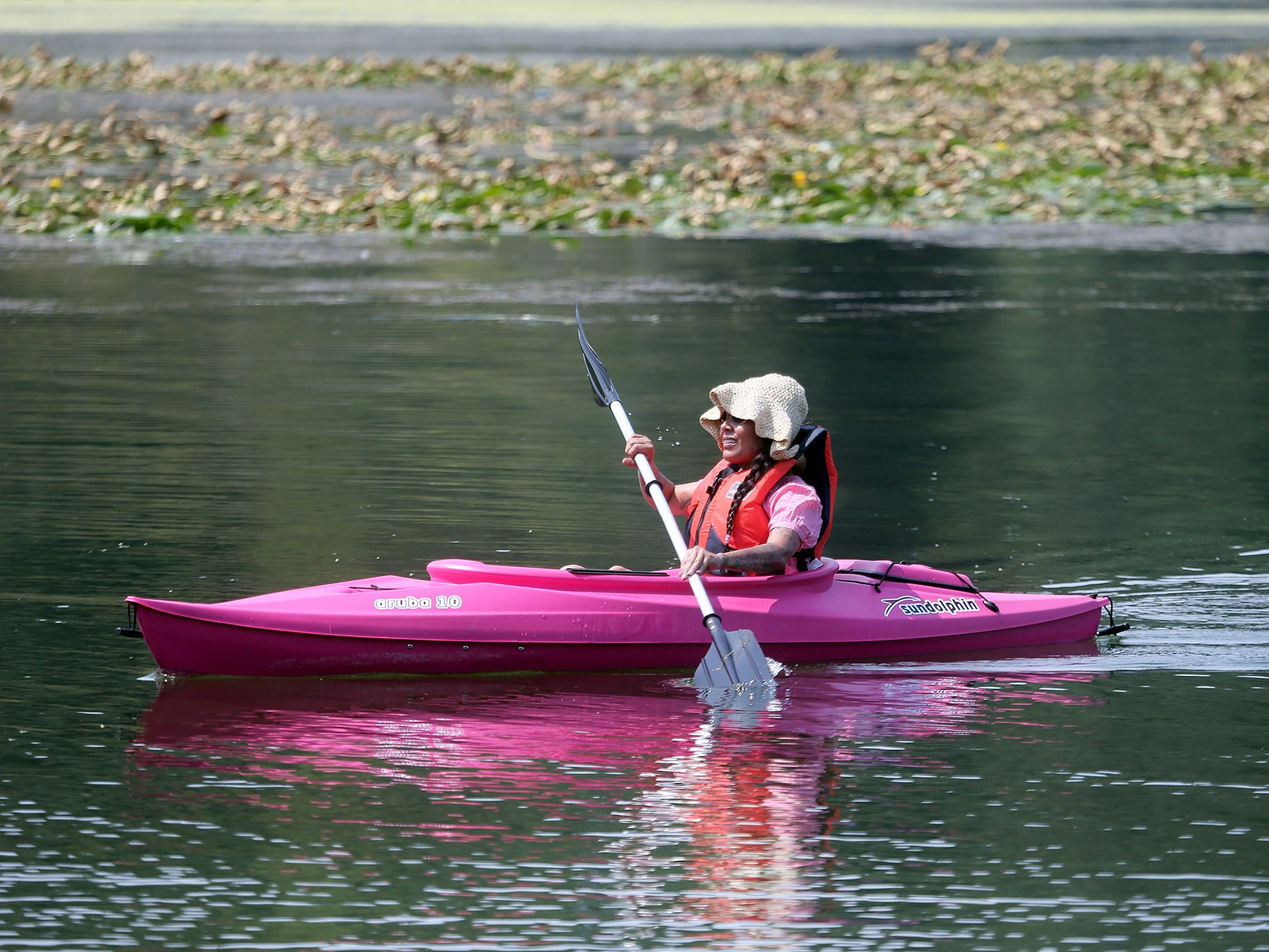 Anna Rope paddles in from kayaking at Kitsap Lake on a hot Monday, August 6, 2018.