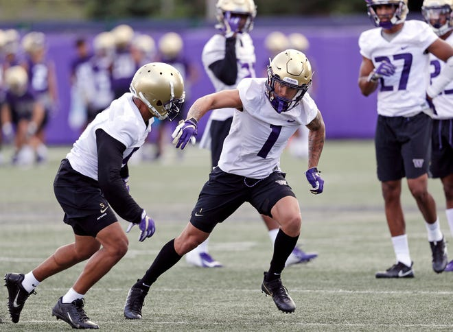 Bryon Murphy (1) and Myles Bryant are members of Washington's star-studded defensive backfield.