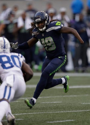 Seattle Seahawks linebacker Shaquem Griffin chases a linebacker during Thursday's preseason opener against Indianapolis. Griffin led the Seahawks with nine tackles.
