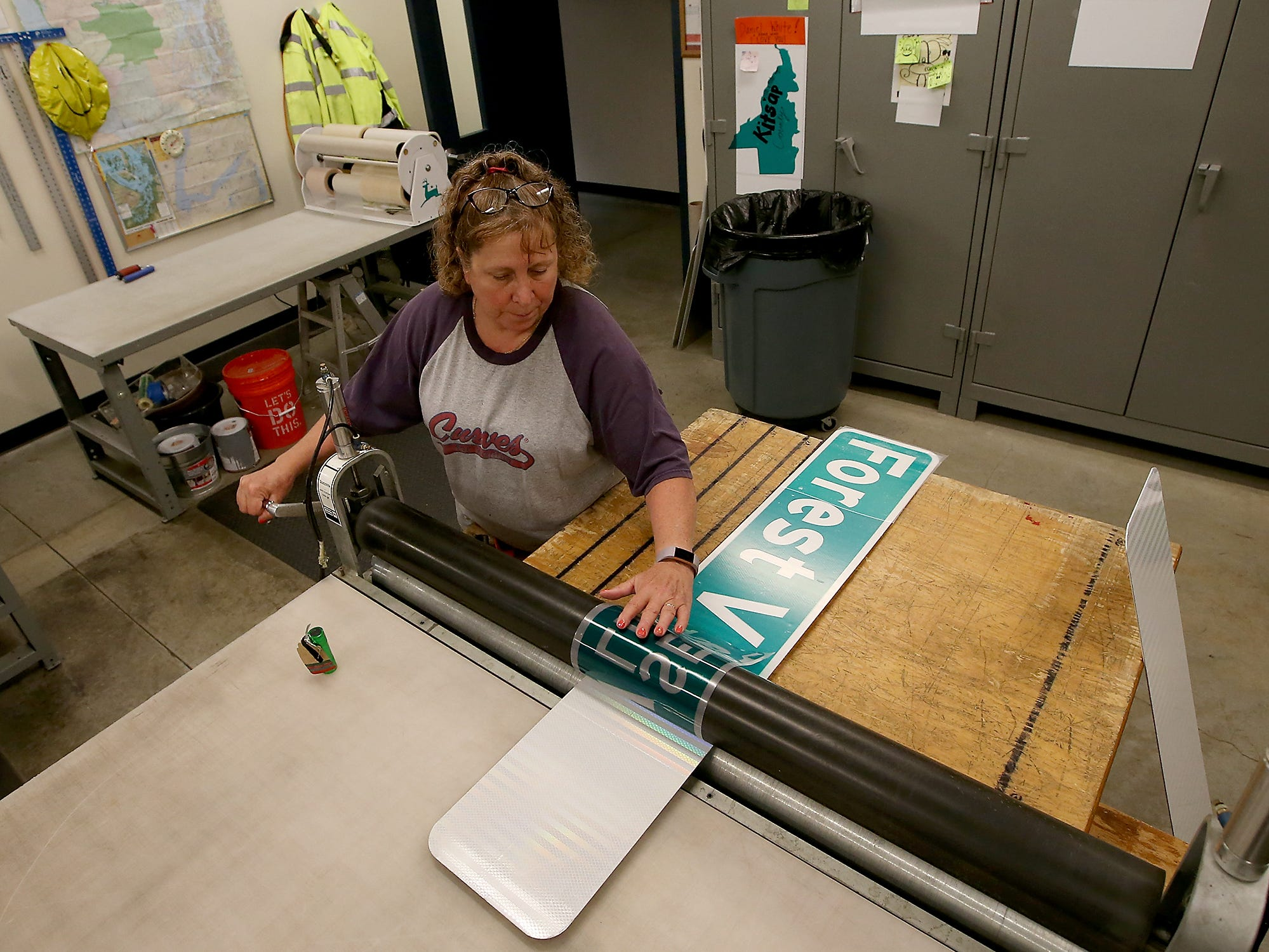 Kitsap County street sign fabricator Lynn McLean makes a road sign for Forest View Lane SE on Thursday, August 2, 2018.