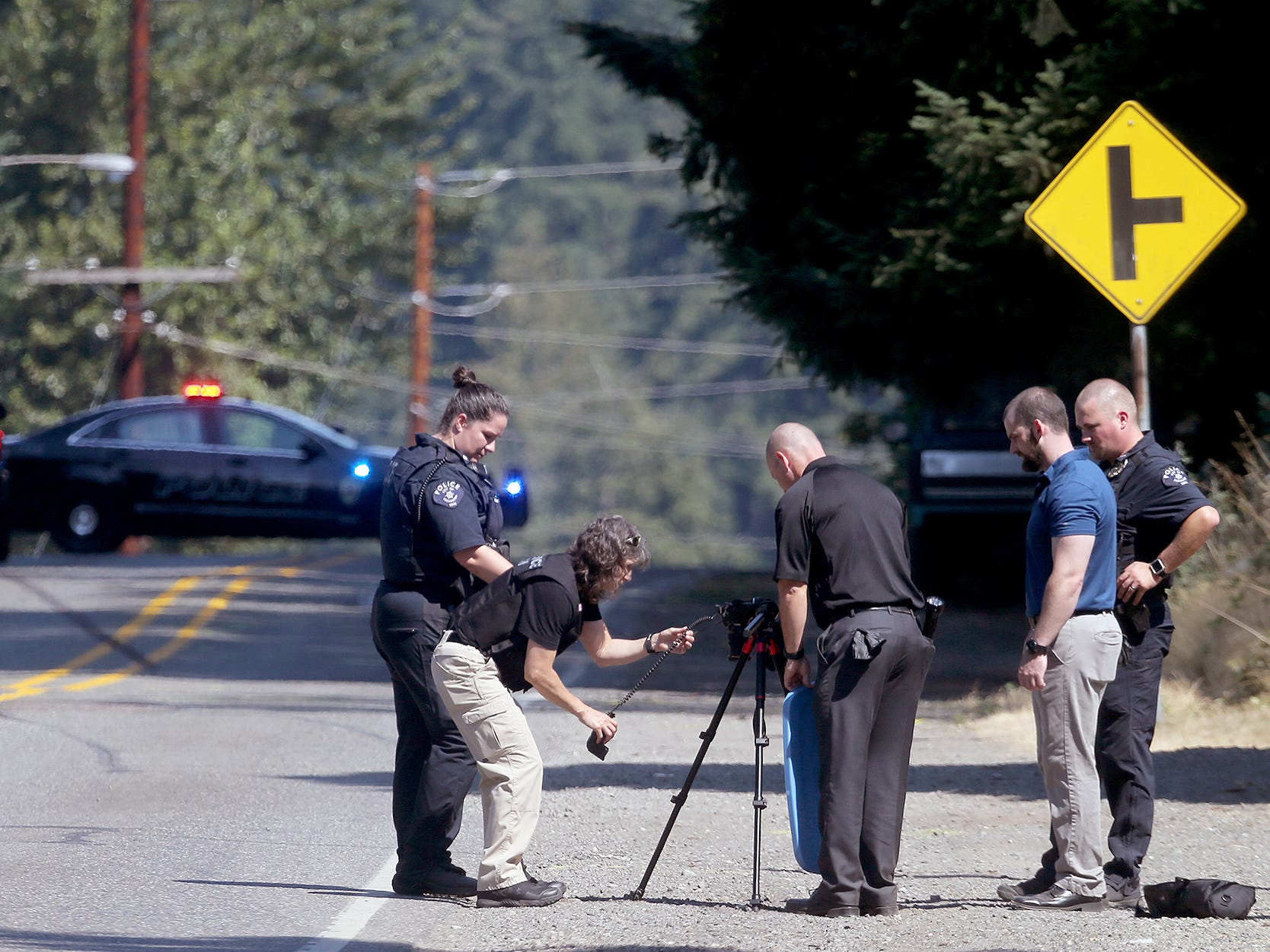 Bremerton Police Department investigators work the scene of a fatality pedestrian accident on National Ave. in Bremerton on Thursday.