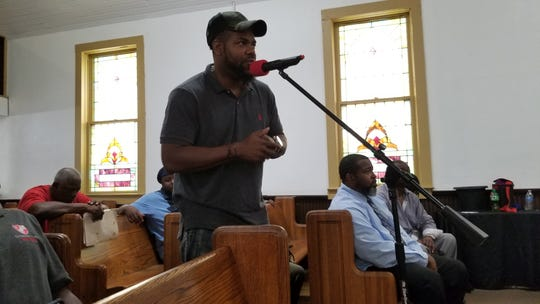 "Royal Barber, who is visiting from California, asked a question of the panel  during a Q&A Saturday at the ""Black Men Speak Out"" event in Cocoa."