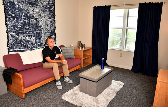 Warren Pittorie, Ph.D student, visits the dorm room set up by Bed, Bath & Beyond at Anderson Hall at the Florida Institute of Technology,which shows examples of the kinds of accessories and furniture they offer that would be right for a dorm room.
