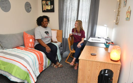 Sophomore students Sarai Thomas and Nicole Wright visited the dorm to see the rooms set up by Courtney Ross, of the Melbourne location of    Bed, Bath & Beyond. She set up sample decor in a dorm room at Anderson Hall at the Florida Institute of Technology, showing examples of the kinds of accessories and furniture they offer that would be right for a dorm room.