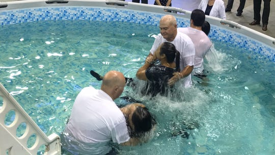 37 members of Jehovah's Witness  were baptized in front of 3,500 people at the Jehovah's Witness 2018 Regional Convention Saturday, Aug. 11, 2018.