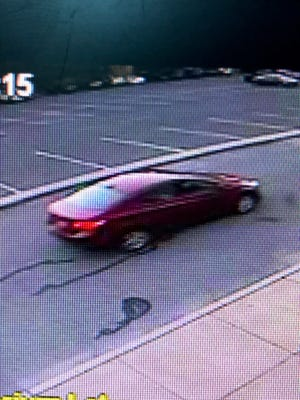 Authorities say this maroon sedan is believed to be the getaway vehicle in a deadly shooting outside Lakeside Middle School in Millville on Thursday night, Aug. 9, 2018.