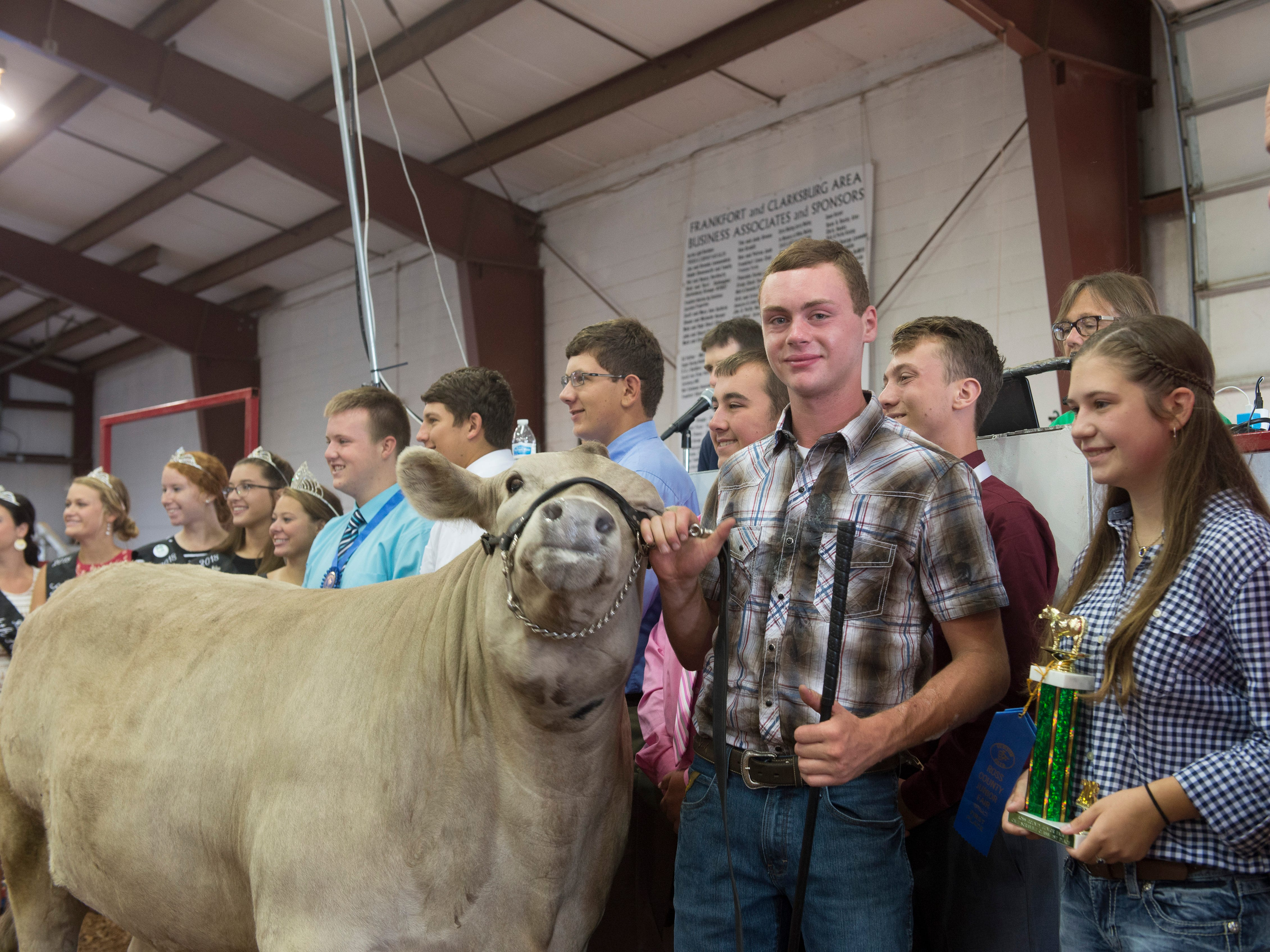 Brayden Thompson poses with his Champion Scramble Calf after auction during the Jr. Fair Market Steer, Poultry and Rabbit Sale at the Ross County Fair on August 11, 2018, in Chillicothe, Ohio.