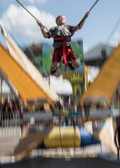 A boy on free ride day enjoys multiple jumps during the Ross County Fair.