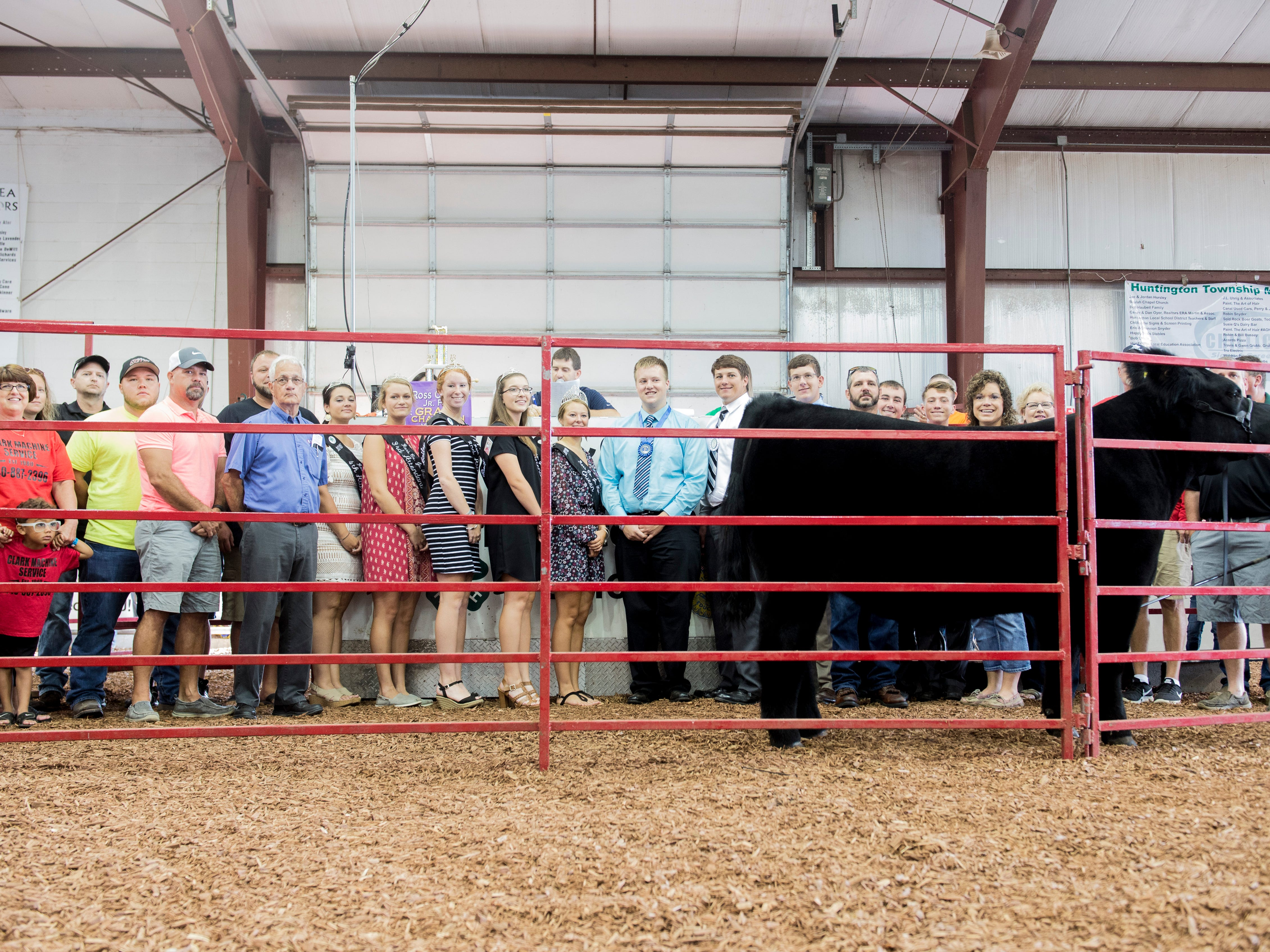 Hudson Drake poses with his Grand Champion Market Steer after auction the Jr. Fair Market Steer, Poultry and Rabbit Sale at the Ross County Fair on August 11, 2018, in Chillicothe, Ohio.