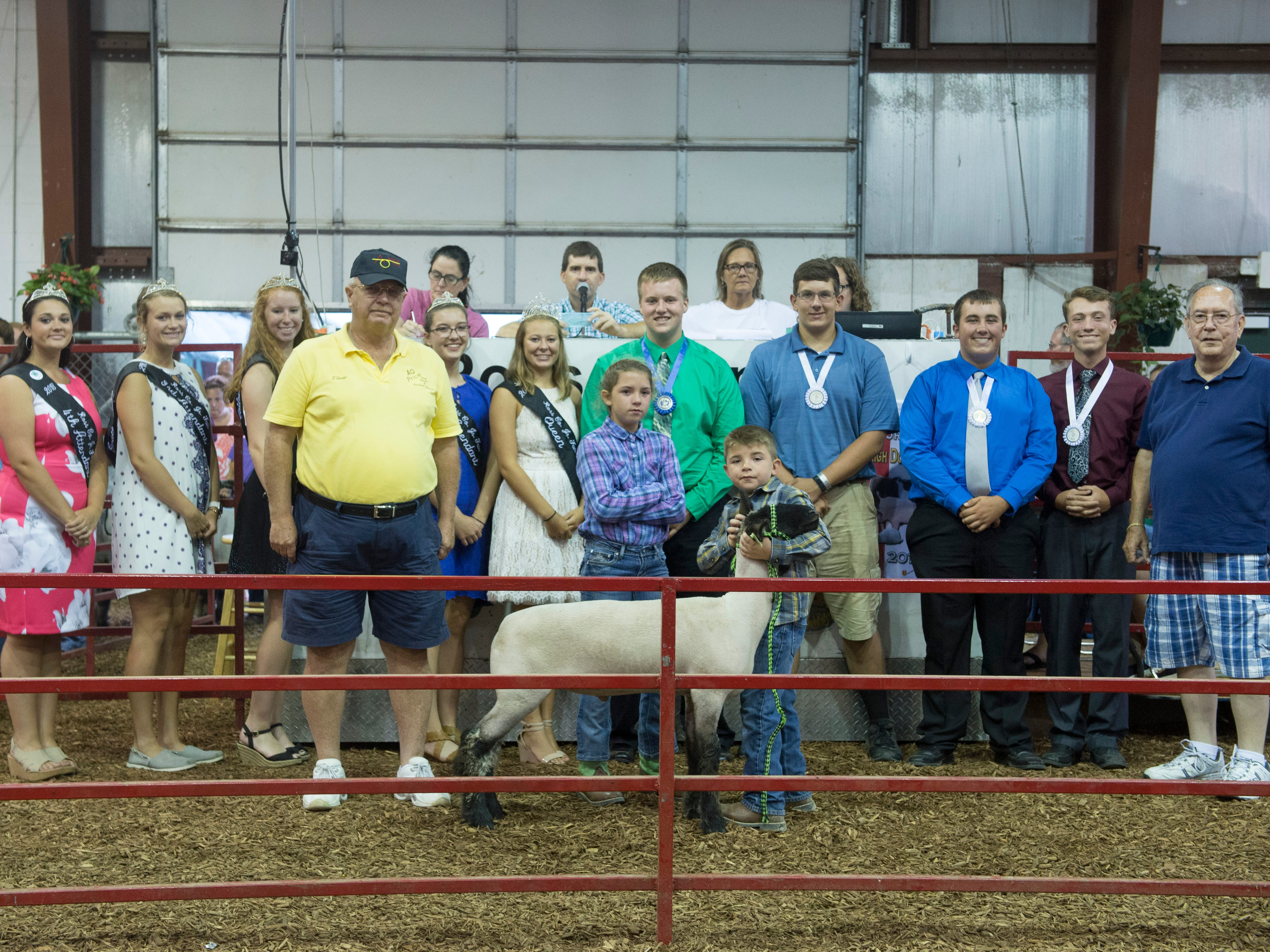 Jadyn and Jace Cantrell post with their endowment lamb after auction during the Jr. Fair Market Lamb Sale at the Ross County Fair on August 10, 2018, in Chillicothe, Ohio.