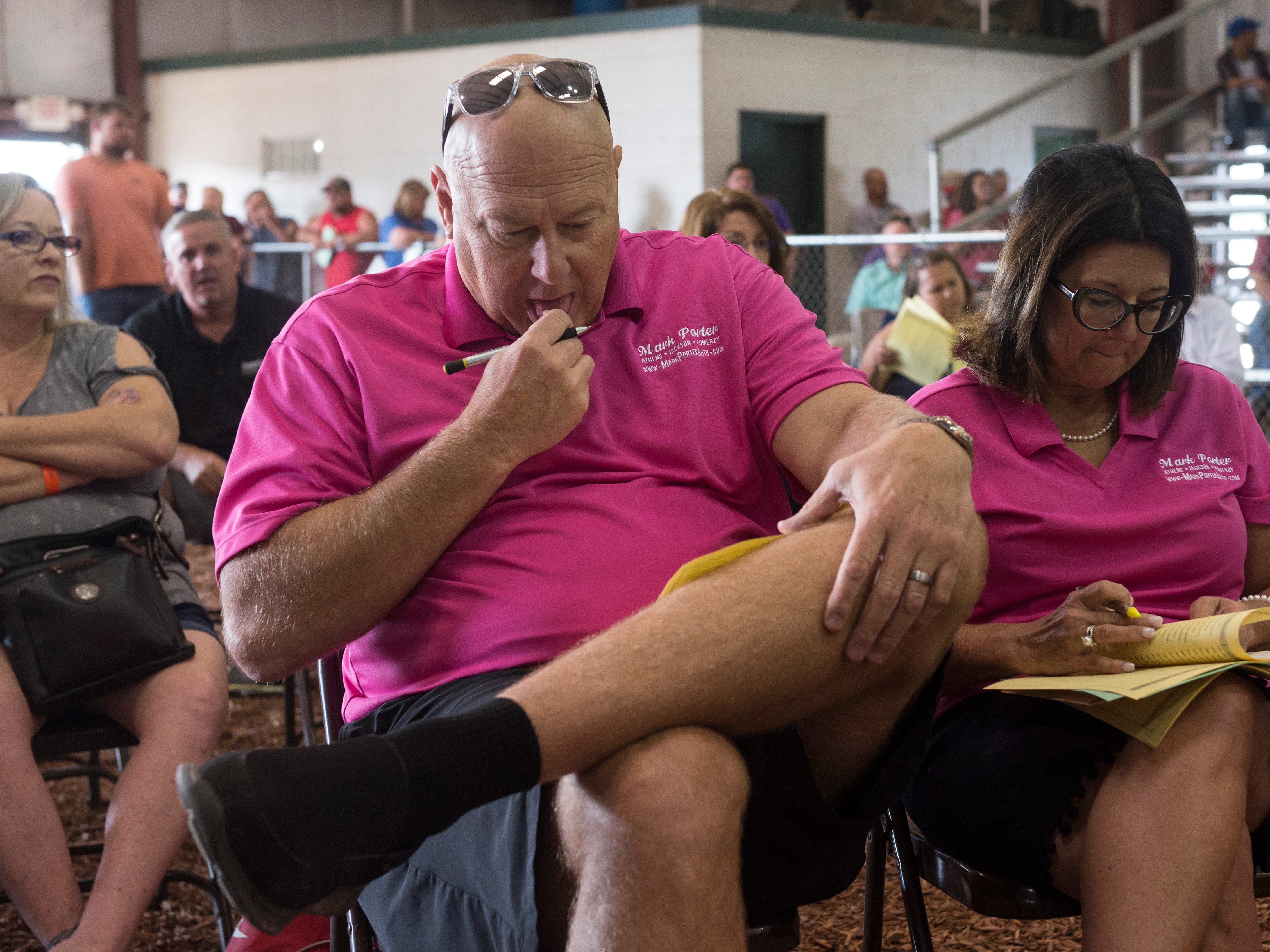 Fair attendees bid on steer during the Jr. Fair Market Steer, Poultry and Rabbit Sale at the Ross County Fair on August 11, 2018, in Chillicothe, Ohio.