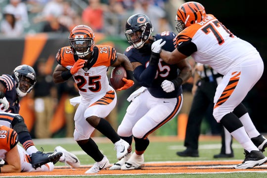 Cincinnati Bengals running back Giovani Bernard (25) finds running room as Cincinnati Bengals offensive tackle Cordy Glenn (77) blocks in the first quarter during the Week 1 NFL preseason game between the Chicago Bears and the Cincinnati Bengals, Thursday, Aug. 9, 2018, at Paul Brown Stadium in Cincinnati.