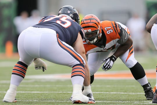 Cincinnati Bengals defensive tackle Geno Atkins (97) lines up for a play in the first quarter during the Week 1 NFL preseason game between the Chicago Bears and the Cincinnati Bengals, Thursday, Aug. 9, 2018, at Paul Brown Stadium in Cincinnati.